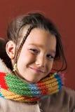 Criança com revestimento e lenço Fotos de Stock