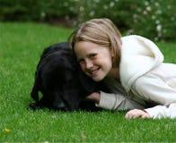 Criança com seu cão Imagens de Stock Royalty Free