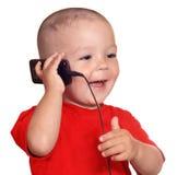 Criança com telefone de pilha Fotos de Stock Royalty Free