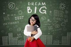 Criança com texto grande ideal no quadro Imagens de Stock