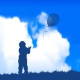 Criança com um balão Fotografia de Stock
