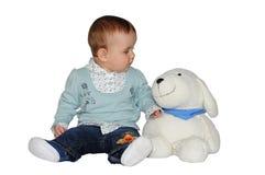 A criança com um brinquedo Fotos de Stock Royalty Free
