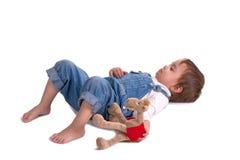 A criança com um brinquedo grita Imagens de Stock Royalty Free