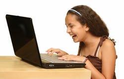 Criança com um computador Imagens de Stock Royalty Free