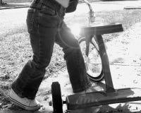 Criança com um triciclo Imagens de Stock Royalty Free