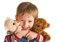 Criança com urso de peluche Fotos de Stock