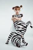 Criança com zebra Imagens de Stock Royalty Free