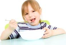 A criança come a sopa Imagem de Stock Royalty Free