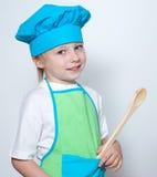 Criança como um cozinheiro do cozinheiro chefe fotos de stock