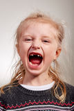 Criança contente na diferença do dente Imagem de Stock