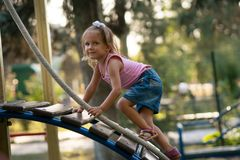 Criança da menina no campo de jogos Foto de Stock Royalty Free