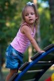 Criança da menina no campo de jogos Fotografia de Stock Royalty Free