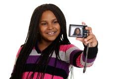 Criança da menina que toma o selfie Fotografia de Stock Royalty Free