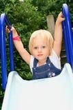 Criança da menina sobre a corrediça Fotos de Stock Royalty Free