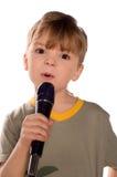 Criança de canto Fotos de Stock