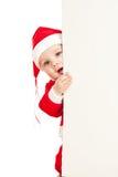 Criança de Papai Noel que olha do cartaz de trás Imagem de Stock Royalty Free