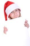 Criança de Santa com uma bandeira Fotografia de Stock
