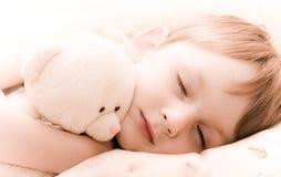 Criança de sono com brinquedo Fotografia de Stock