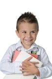 Criança de sorriso em seu primeiro dia da escola Imagens de Stock