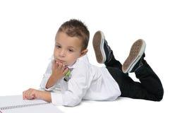 Criança de sorriso em seu primeiro dia da escola Fotografia de Stock