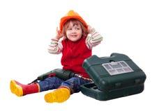Criança de sorriso no capacete de segurança do construtor com ferramentas Fotos de Stock