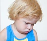 Criança desagradada com bordos pouty Imagens de Stock