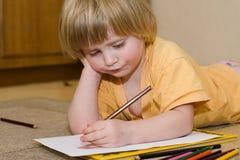 A criança desenha Imagem de Stock