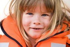 Criança do colete salva-vidas foto de stock royalty free