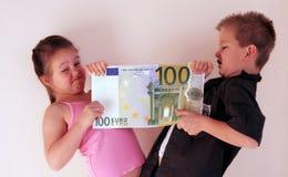 Criança do dinheiro Fotos de Stock Royalty Free