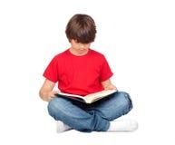 Criança do estudante com um livro imagens de stock royalty free