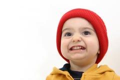 Criança do menino do inverno com sorriso grande fotos de stock royalty free