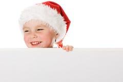 Criança do Natal feliz com a placa fotografia de stock