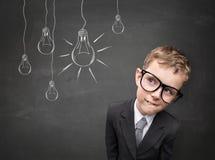 Criança do negócio que tem uma ideia Imagem de Stock