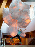 Criança do paraquedas que salta com nuvens Fotografia de Stock Royalty Free