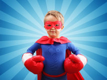 Criança do super-herói com luvas de encaixotamento Foto de Stock Royalty Free