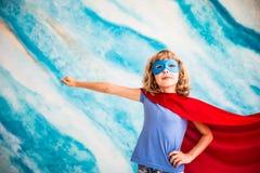 Criança do super-herói em casa Imagem de Stock Royalty Free