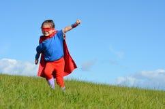 Criança do super-herói - poder da menina Fotos de Stock