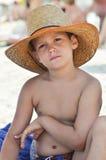 Criança do vaqueiro em uma praia Imagens de Stock Royalty Free