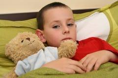 Criança doente com gripe Imagens de Stock Royalty Free