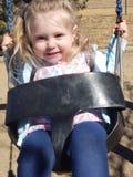 Criança dos olhos azuis no parque imagem de stock