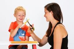 Criança e baby-sitter Fotos de Stock Royalty Free