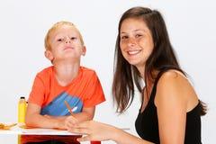 Criança e baby-sitter Fotos de Stock