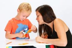 Criança e baby-sitter Foto de Stock Royalty Free