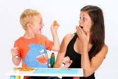 Criança e baby-sitter Fotografia de Stock