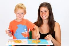 Criança e baby-sitter Fotografia de Stock Royalty Free