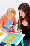 Criança e baby-sitter Imagens de Stock