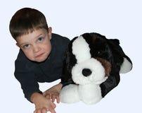 Criança e cão do menino Fotos de Stock