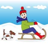 Criança e cão na neve Foto de Stock Royalty Free
