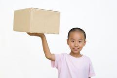 Criança e caixa Fotografia de Stock Royalty Free