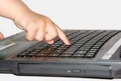 criança e computador pequenos Imagem de Stock